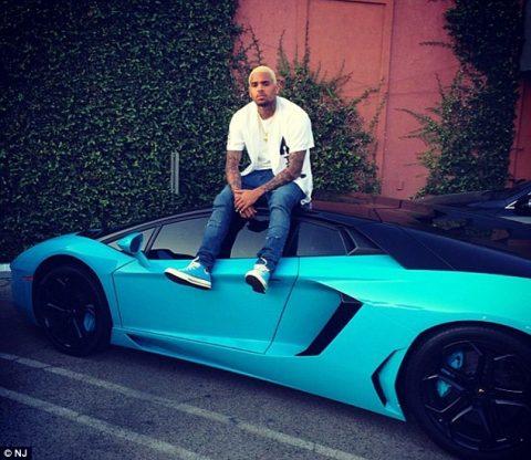 29CA695F00000578-3132018-Bubble_gum_blue_Chris_and_his_bright_blue_Lamborghini_Aventador_-m-9_1434746947630